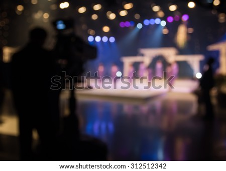 Actress or singer in studio of television station with camera - stock photo