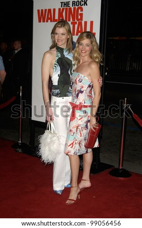Actresses MISSI PYLE (left) & CHRISTINA MOORE at the world premiere, in Hollywood, of Walking Tall. March 29, 2004