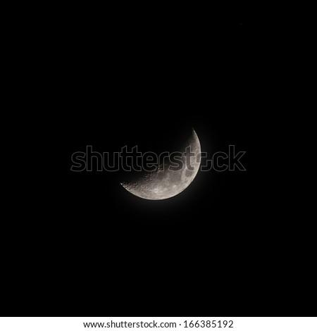 Actual Crescent Moon in the dark sky - stock photo