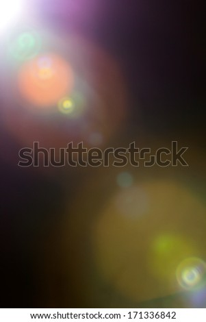 actual lens flare, optical effect made in camera - stock photo