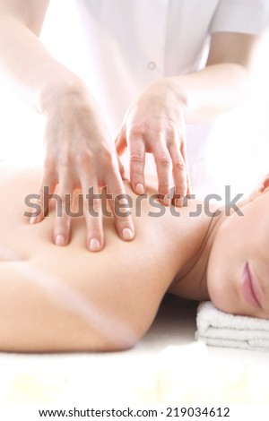 Acupressure point massage, a woman a massage  .Slimming massage .Attractive blonde woman in the office spa, relax with a massage  - stock photo