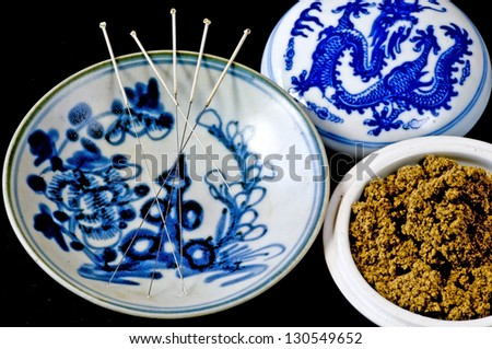 acupuncture needles and moxa wool - stock photo