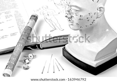 acupuncture needles,model and moxa cigar with textbook - stock photo