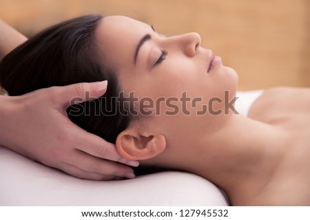 Acupuncture treatment in the head of an asian woman - stock photo