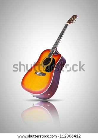 acustic guitar with reflection isolated on grey background