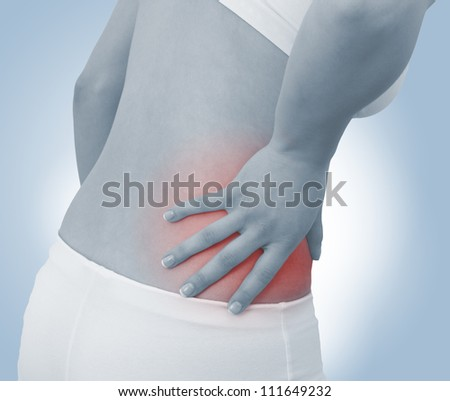 Acute pain in a woman abdomen. Female holding hand to spot of Abdomen-ache. Concept photo with Color Enhanced blue skin with read spot indicating location of the pain.
