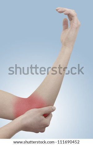 Acute pain in a woman elbow. Female holding hand to spot of elbow pain. Concept photo with Color Enhanced skin with read spot indicating location of the pain. - stock photo