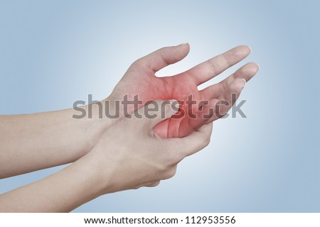 Acute pain in a woman hand. Isolation on a white background. Color Manipulation image to emphasize the pain. - stock photo