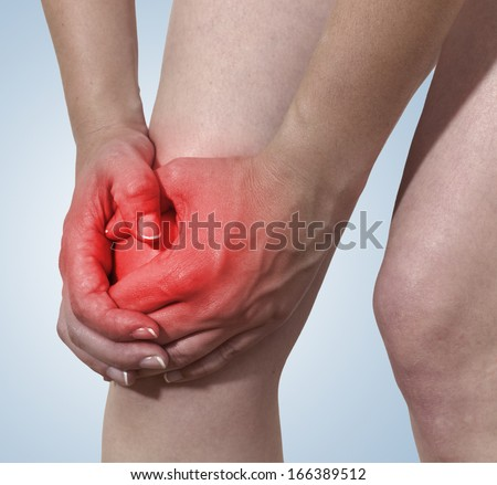 Acute pain in a woman knee.  - stock photo
