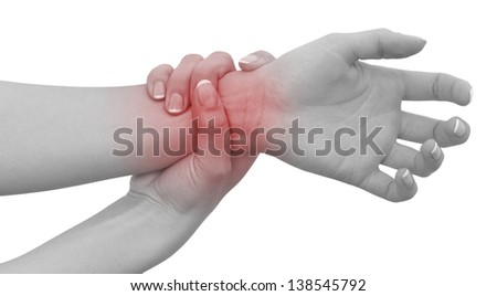 Acute pain in a woman wrist. Female holding hand to spot of wrist pain. Concept photo with Color Enhanced blue skin with read spot indicating location of the pain. Isolation on a white background. - stock photo