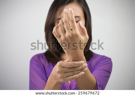 Acute pain in a women wrist - stock photo