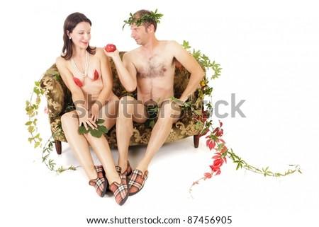 adam and eve original sin concept, man seducing woman - stock photo