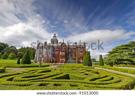 Adare manor in red ivy and gardens, Co. Limerick, Ireland - stock photo