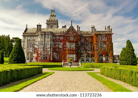 Adare mansion in red ivy in Ireland - stock photo