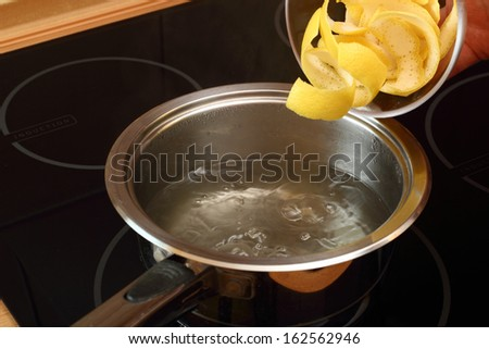 Add lemon peel into saucepan with boiling syrup. Candied Lemon Zest Cooking. Series.
