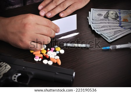 addict makes track of cocaine, close up - stock photo