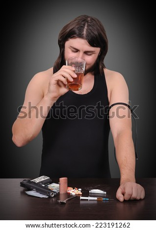 addict man drinking alcohol from a glass - stock photo