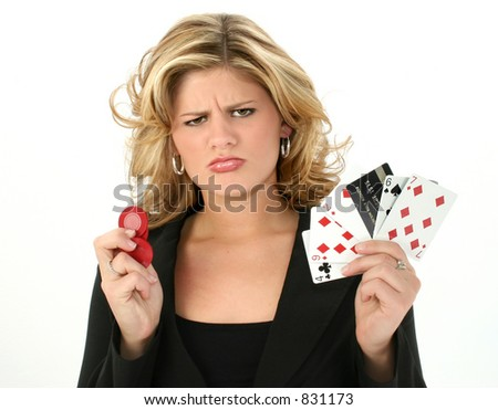 Addicted gambler woman with bad poker hand and credit card frowning. - stock photo