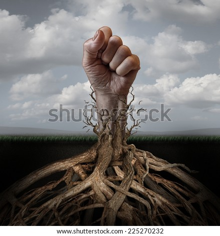 Addiction freedom and breaking out concept as a human hand in a fist escaping from tree roots holding it down as a symbol for human rights and fighting for individual independence and liberation. - stock photo