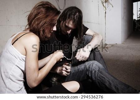 Addiction - people on street deep in drugs - stock photo