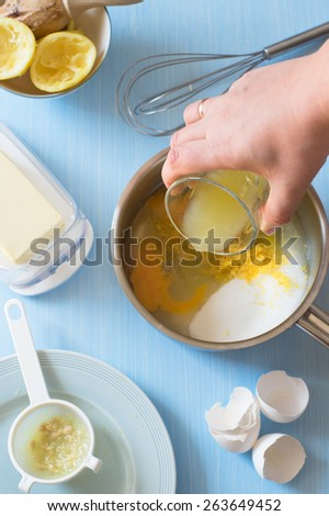 Adding in the Saucepan Ingredients for Lemon Curd. Selective Focus - stock photo
