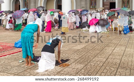 Addis Ababa: Apr 10: Ethiopian Orthodox followers bow down hundreds of times to worship God, and remember the suffering of Christ, during Siklet (crucifixion) on April 10 ,2015 in Addis Ababa,Ethiopia - stock photo