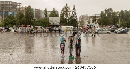 Addis Ababa: Apr 10:Ethiopian Orthodox followers stand undeterred by the pouring rain to observe Siklet, the crucifixion of Jesus Christ, a Medhane Alem Church on Apr 10 ,2015 in Addis Ababa, Ethiopia - stock photo
