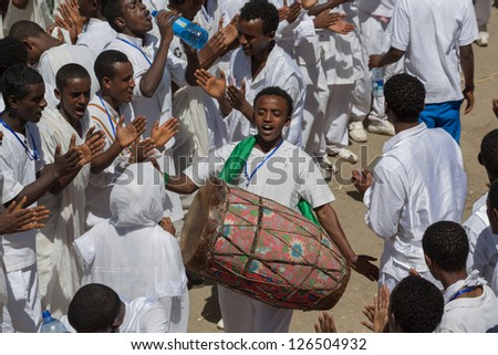 ADDIS ABABA, ETHIOPIA - JANUARY 20: Ethiopian Orthodox followers sing and chant during a colorful procession which is part of Timket celebrations of Epiphany, on January 19, 2013 in Addis Ababa, Ethiopia. - stock photo