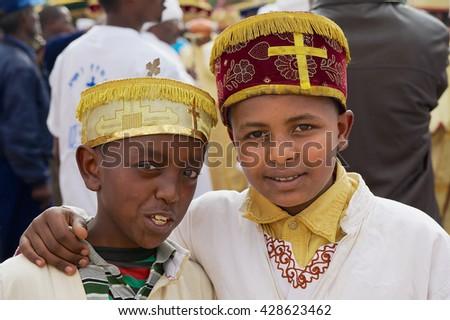 ADDIS ABABA, ETHIOPIA - JANUARY 18, 2010: Portrait of two unidentified Ethiopian boys wearing traditional costumes during Timkat Christian Orthodox religious celebrations in Addis Ababa, Ethiopia.  - stock photo