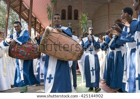 ADDIS ABABA, ETHIOPIA - May 21: A young member of the Ethiopian Orthodox Church Choir sing and chant accompanied by a drum during a colorful procession on May 21, 2016 in Addis Ababa, Ethiopia - stock photo
