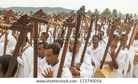 Addis Ababa - Jan 19: Clergy play Begena, a traditional string instrument, while accompanying the Tabot, a model of the arc of covenant, during Timket celebrations, on January 19, 2014 in Addis Ababa. - stock photo