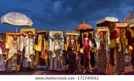 Addis Ababa - Jan 18: Priests carry the Tabot, a model of the Arc of Covenant, during Timket celebrations of Epiphany, commemorating the baptism of Jesus, on January 18, 2014 in Addis Ababa. - stock photo
