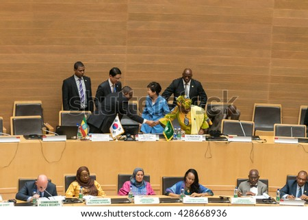Addis Ababa - May 27: H.E. Dr. Nkosazana Dlamini Zuma, Chairperson of the AUC, shakes hands with the Prime Minister of Ethiopia, after her speech, on May 27, 2016, in Addis Ababa, Ethiopia. - stock photo