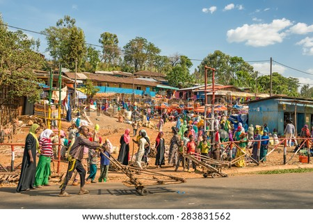 ADDIS ABBABA, ETHIOPIA - MAY 1, 2015 : Popular and crowded african market near Addis Abbaba, Ethiopia with many  people buying and selling. - stock photo