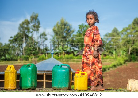 ADDIS ABBABA, ETHIOPIA - MAY 1, 2015 : Young ethiopian girl going for water near Addis Ababa. - stock photo