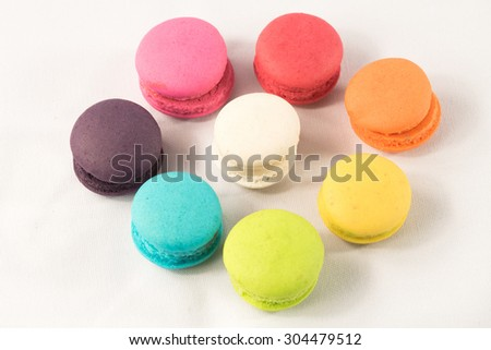 additional french colorful macaroon at symbol of circle complementary color.