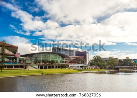 Adelaide, Australia - August 27, 2017: Adelaide city view across Torrens river from footbridge  during winter time