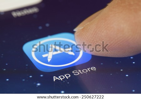 Adelaide, Australia - September 23, 2013: Clicking the App Store icon on an ipad running iOS. iOS is the foundation of iPhone, iPad, and iPod touch. It comes with a collection of apps and useful - stock photo