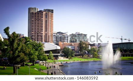 Adelaide skyline and Torrens River at sunset - stock photo