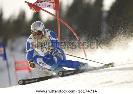 ADELBODEN SWITZERLAND JANUARY 06, Italy's ski racer Peter Fill attacks a gate while Competing in the Audi FIS Alpine Ski World Cup Event in Adelboden, Switzerland, 06/01/2008 - stock photo