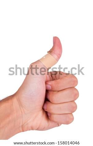 Adhesive bandage, plaster on thumb, isolated on white background. - stock photo