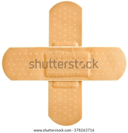 Adhesive first-aid bandage in cross shape  - stock photo