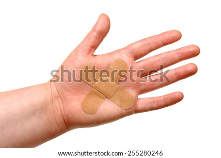 Adhesive plaster pasted on hand at the wound site is isolated on a white background - stock photo