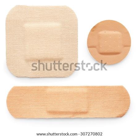 Adhesive plasters isolated on white background - stock photo