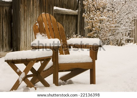 adirondack chair in winter snow