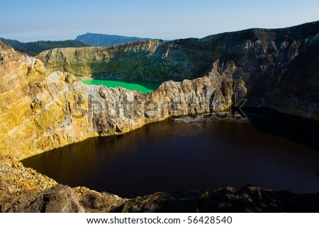 Adjacent green and red/brown volcanic lake at Kelimutu National Park, Indonesia. - stock photo