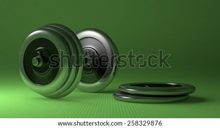 Adjustable metallic dumbbell and weight disks lying on green checkered background