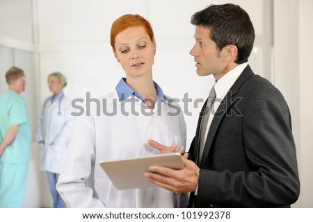 Administrator talking with Doctor at the Hospital