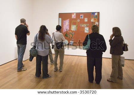 Admiring art - stock photo