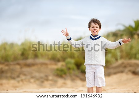 Admiring little boy enjoying beach vacation - stock photo